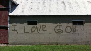 Lovina's three youngest children got creative and took a water hose to write these words on the side of their barn.
