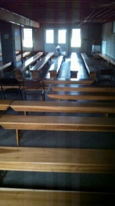 Amish baptism services are larger than normal church services, so extra benches like these are brought on the bench wagon to the house or barn where the special church service will be held.