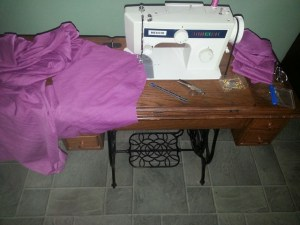 """Lovina has been busy sewing dresses for her and her daughters for a family wedding next week. This is the dress her daughter Verena will wear as a """"table waiter,"""" or server, at the wedding meal."""