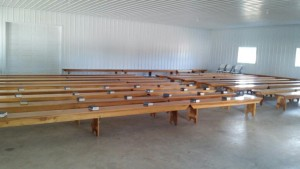 The Eichers set up benches for church services in their new pole barn.